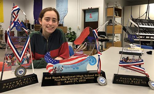 Charlotte Jansky, Little Silver, displays the honors RBR band students amassed at the2019 Virginia International Music Festiv