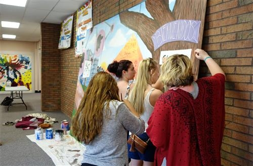 Students put finishing touches on their art gift to RBR