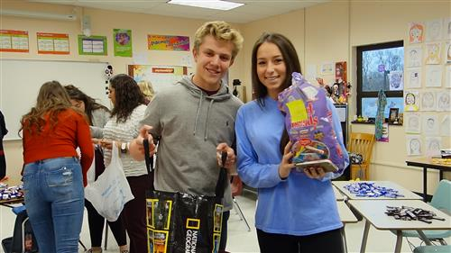 RBR Spanish National Honor Society Students Ben Smelas and Chloe Rosen display the holiday stuffing for holiday stockings