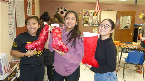 Spanish Honor Society students display holiday stockings for troops