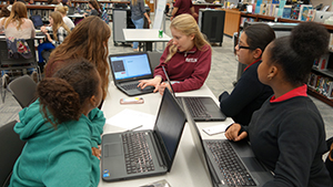 RBR tech students work with middle school students in the Girls Who Code program