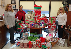 The SOURCE and Buc Backers collaborate to bring holiday gifts to RBR families