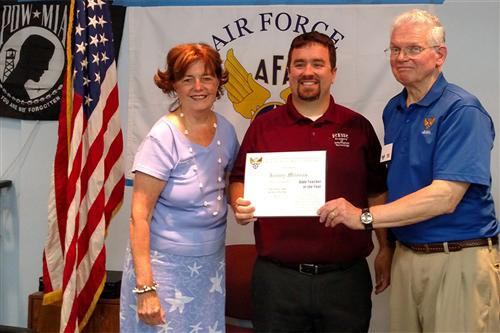 RBR technology teacher Jeremy Milonas of Holmdel is pictured flanked by Maxine Rauch, President of the Air Force Association