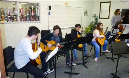 RBR Guitar Majors practicing in their RBR classroom.  John Simone is pictured second from left.