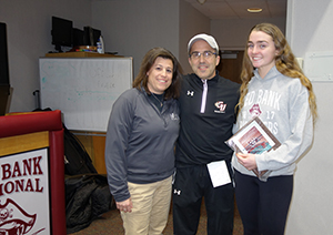 Meghan Murray,  is pictured with athletic trainer, Christine Emrich, and coach John Truhan III