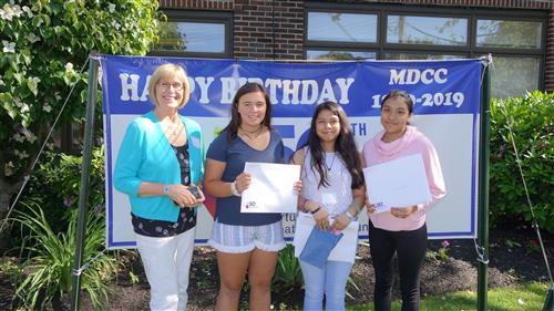 Barbara Beckett with three of her students whose art was selected as part of the Monmouth Day Care Center Art Journal