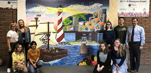 RBR senior studio art majors with their mural and their client, the RBR Superintendent who commissioned it.