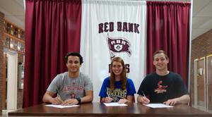 althetes playing Division I ball next year: Sam McPherson, Marissa Alabano and Dan Vilardi