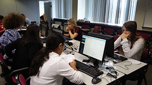 High School student attend a free cybersecurity summer camp to learn more about this subject