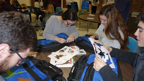 Students decorate cases for foster children