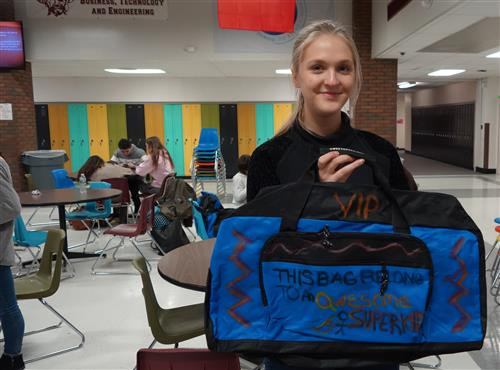 Claire Taylor with her decorated bag for foster child