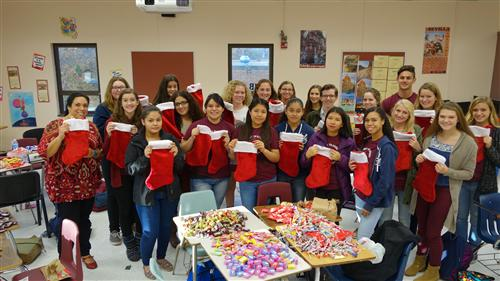 Forty members of The Red Bank Regional (RBR) National Spanish Honor Society spent their afternoon stuffing stockings filled w