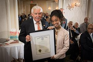Suubi Mondesir of Red Bank is pictured with New Jersey Assemblyman Eric Houghtaling