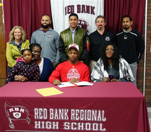 RBR Football Captain Chris Outterbridge signs to play football at Sacred Heart University