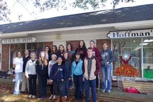 RBR student artists are pictured with their teacher Claudia O'Connor and Ye Old Pie Shoppe owners, Eileen and Tom  Caruso, in