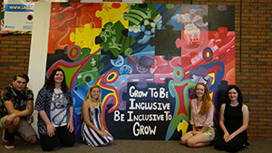 Studio Art Majors pictured with the mural they created