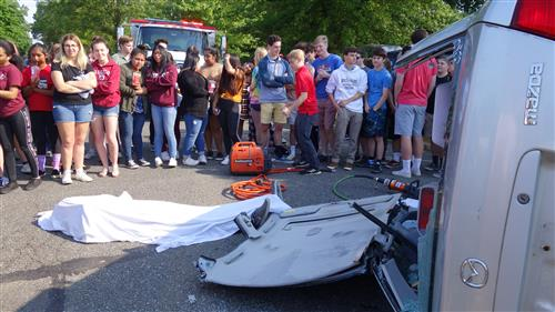 RBR students watch the Project Prom Mock Crash.  One of their Teachers, Scott Ferris portrays a DOA victim.