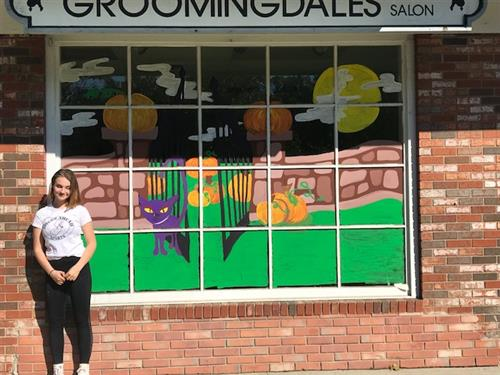 RBR VPA studio art major, Lucy Woodrow painted Groomingdales Salon's windows