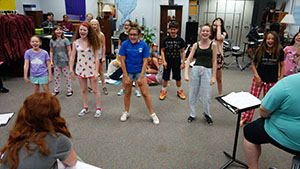 "RBR VPA Summer Academy students rehearse for their upcoming show, ""Attack of the Pom-Pom Zombies"