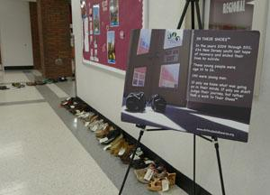 Shoes line the RBR corridors in a display representing the 233 young people who lost their lives
