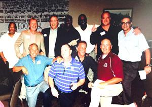 RBR's athletic director Del Dal Pra with members of the 1975 RBR State Champions
