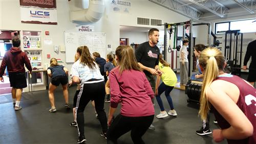 strength coach Jack Provine trains the off-season Girls' Lacrosse team and other students