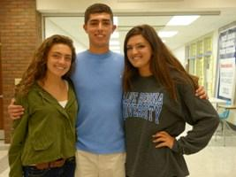 Jon Pierce is pictured between his Triplet sisters Isabella and Victoria.