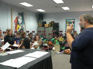 Pictured is Director Kris Zook conducting auditions for the show among his performers.