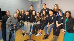 Members of RBR's Interactive Media class pose with the real life news team of WPIX 11 News