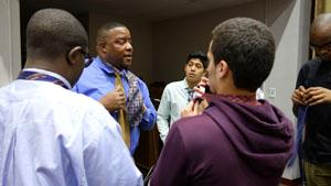 RBR Boys 2 Men facilitator and SOURCE clinician teaches his students the art of tying a tie