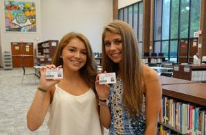 RBR freshmen Gillian Foster and Theresa Decker, both of Shrewsbury show their school ID cards.