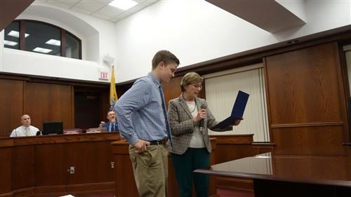 Council President Kathleen Horrigan presented Jack with a certificate  in appreciation of his art design