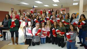 RBR Spanish and French Honor Society Students Stuff Stockings for Troops