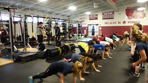 Students train after-school in a total-body workout in RBR's new fitness center.