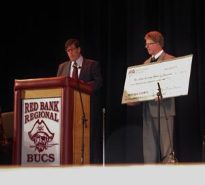 RBR Buc Backer President Paul Noglows recently presented  Peter Grandinetti with a very large check